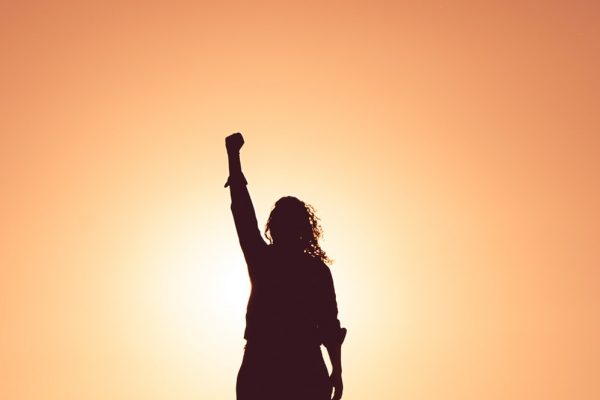 Woman holding fist to the sky